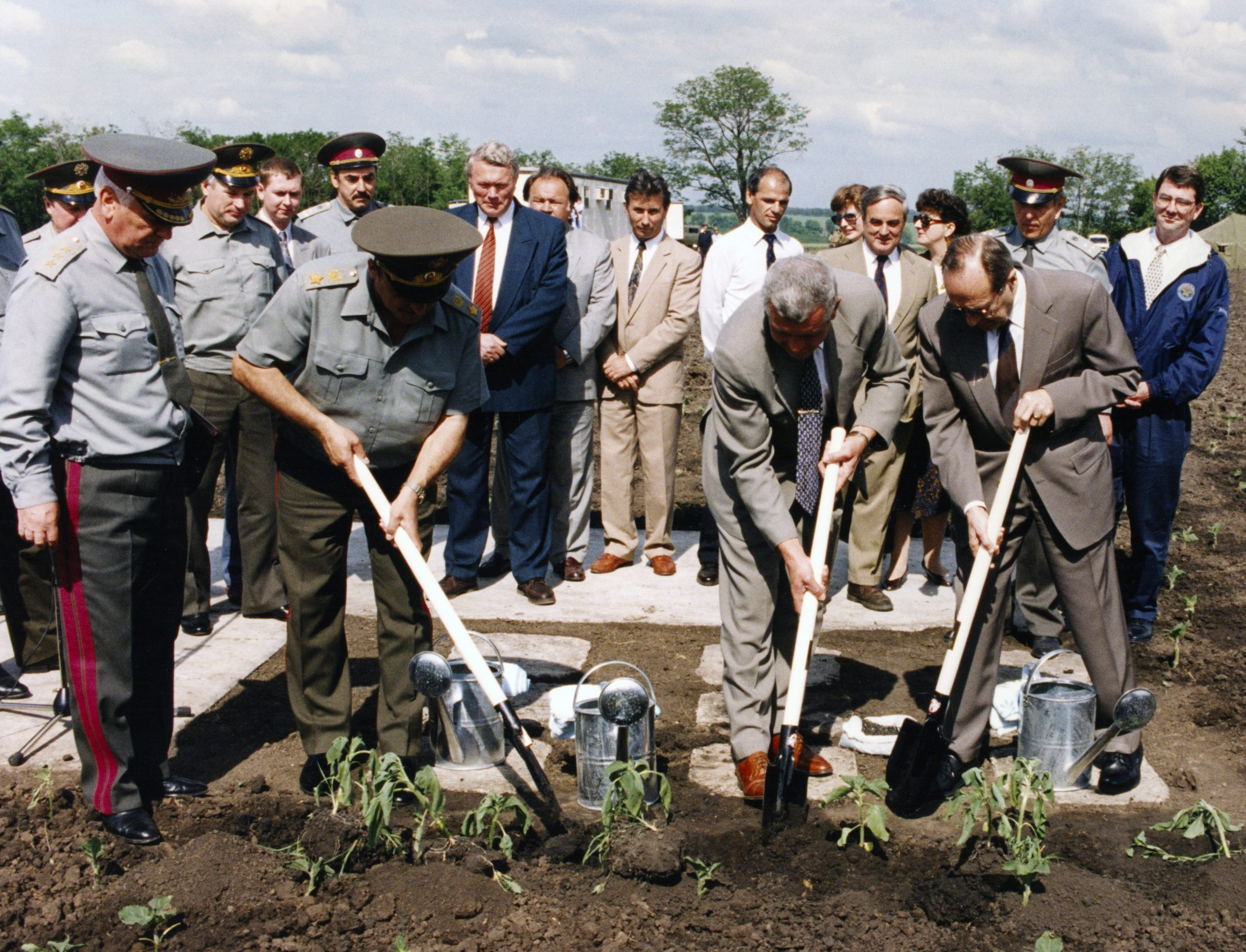 Planting sunflowers in former Soviet missile field (Perry, front right, Ash Carter, rear right)