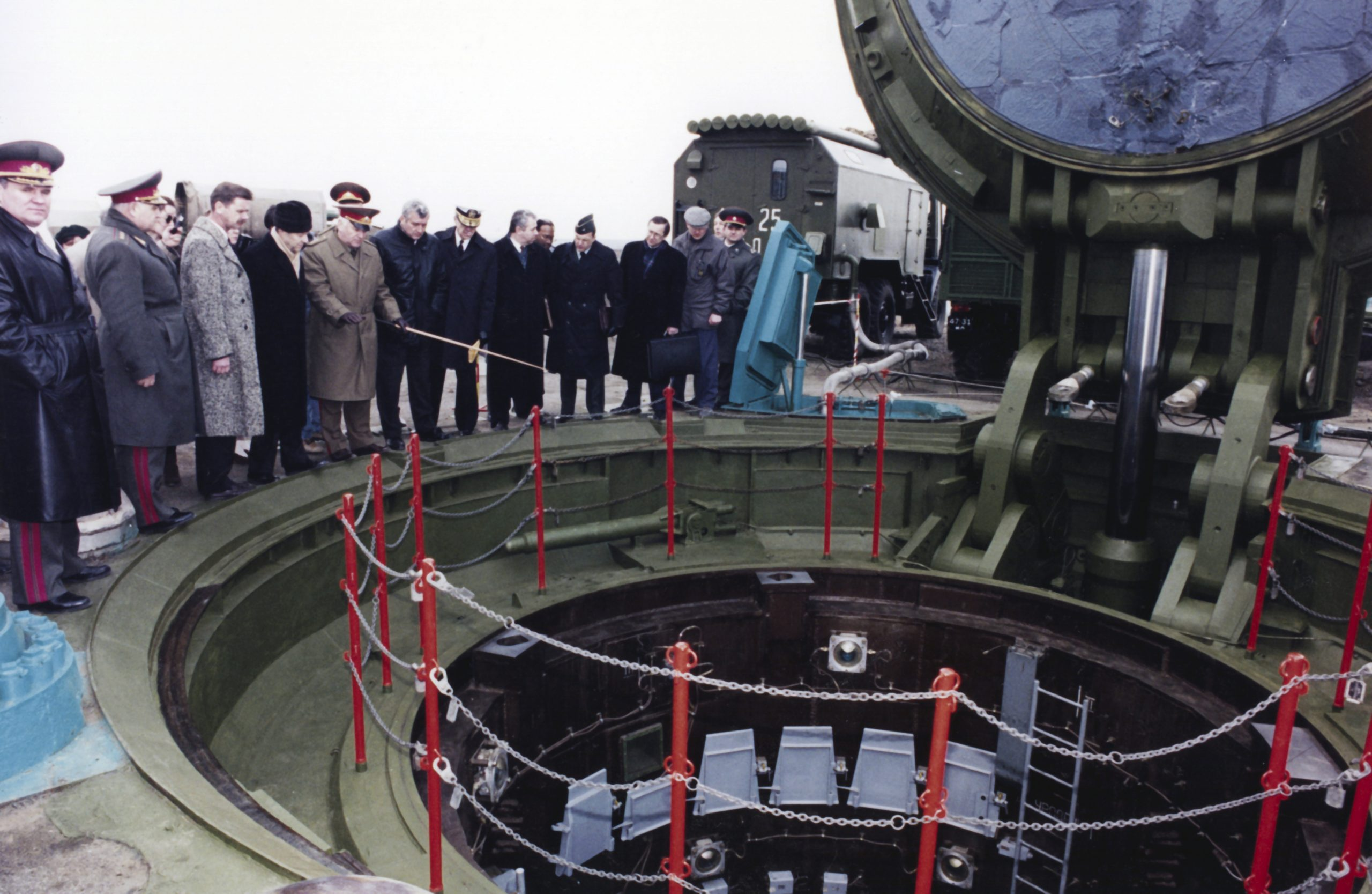 Perry (4th from left, black hat) staring into Soviet ICBM silo