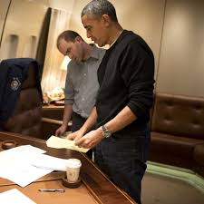 President Obama confers with Ben Rhodes